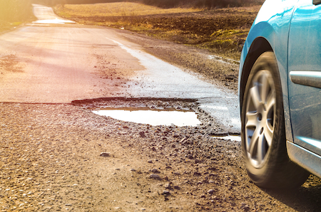 How Potholes Damage Your Car's Wheel Alignment and Suspension